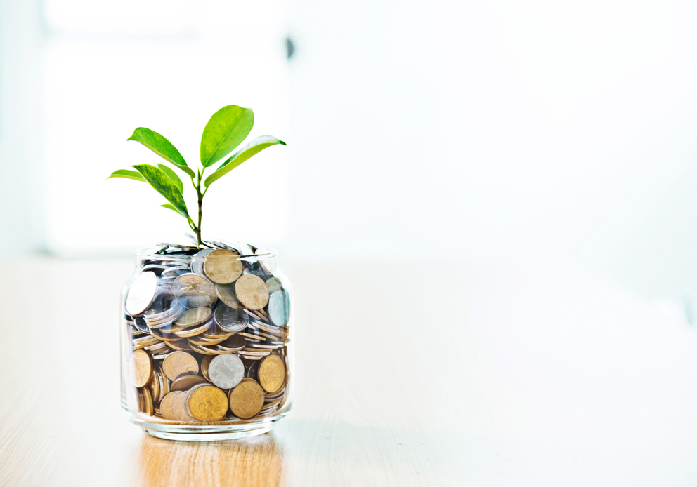 compensation and rewards consultation | coins in a glass jar | Pivot HR Services