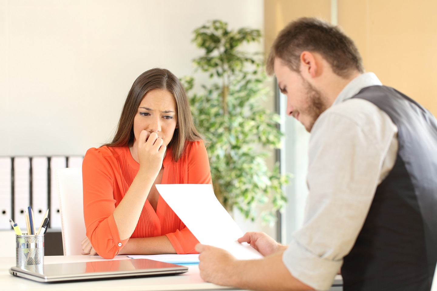 woman acting nervous in interview | Pivot HR Services